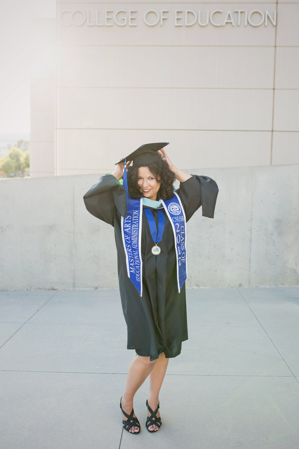 This was my absolute favorite from the session.  Nothing can top standing in front of the building she went to for classes- the college of education, wearing her cap and gown!  Oh and that smile and flirty feet!