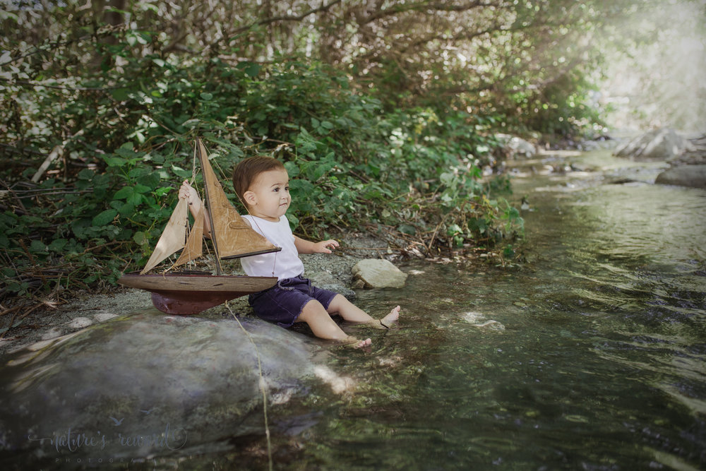 The little sailor.  Creekside San Bernardino Mountain Portrait of baby and his sail boat!  Image by Nature's Reward Photography, a Southern California newborn, family and child photographer