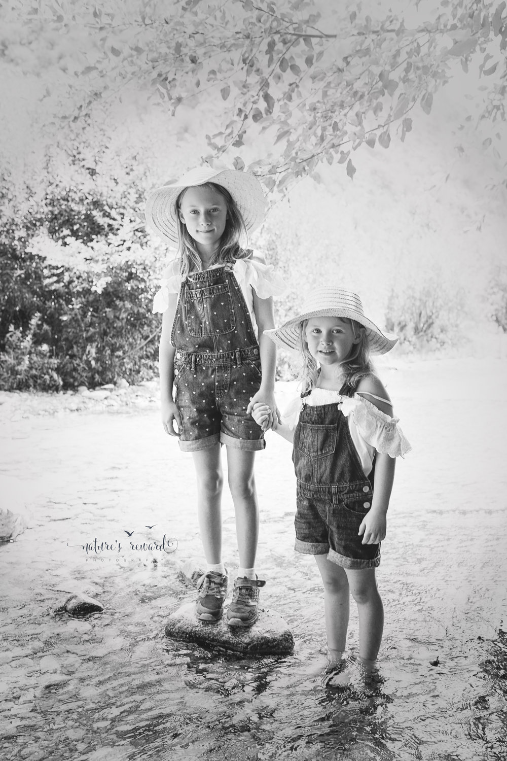 Black and white of these daughters in the water- Portrait by Nature's Reward Photography- a southern California photographer