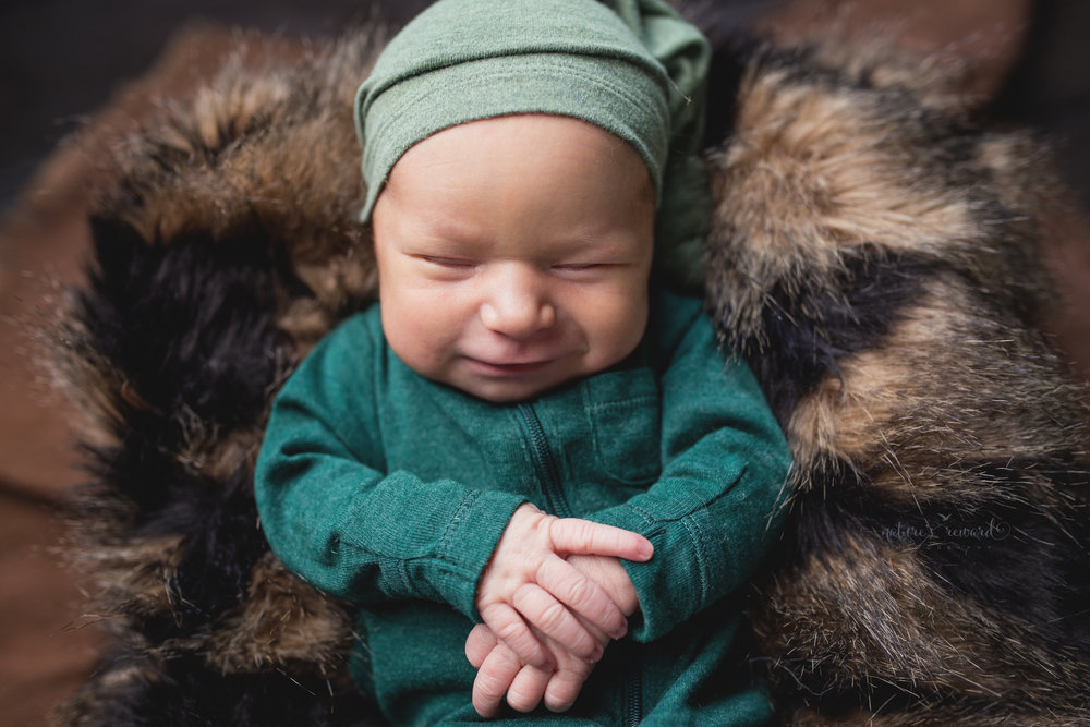 And as if it wasn't enough cuteness already this baby decked in green with his sleeper hat on, smiled yet again.