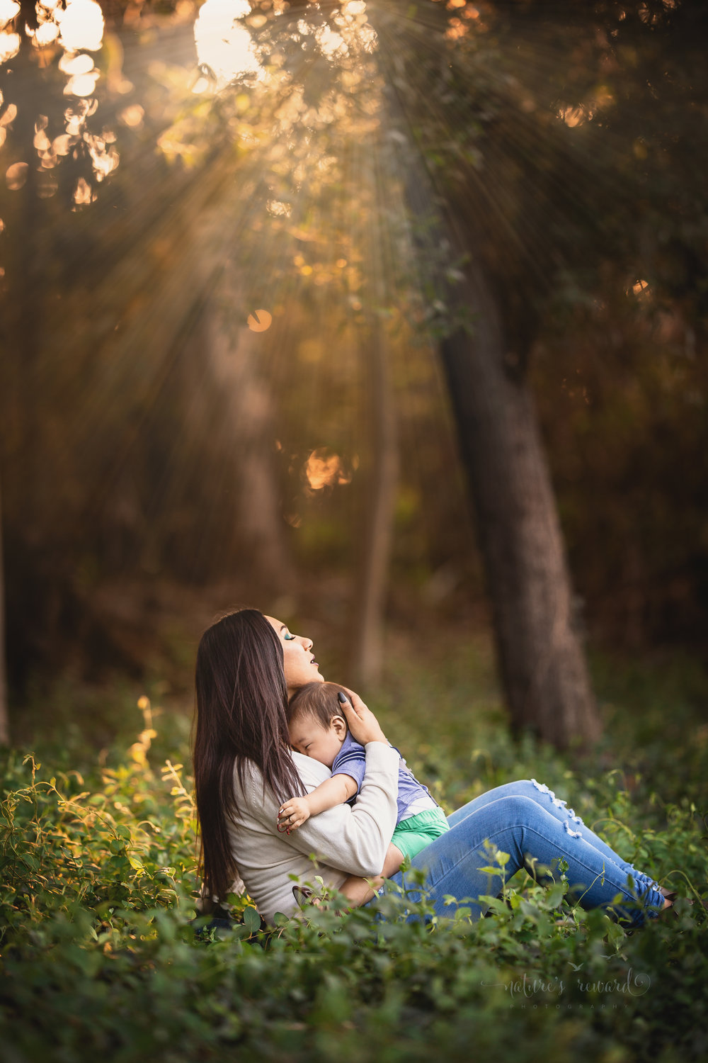 My favorite portrait from this beautiful session.  Mother and son cuddle in the light in this in this lovely portrait by Nature's Reward Photography