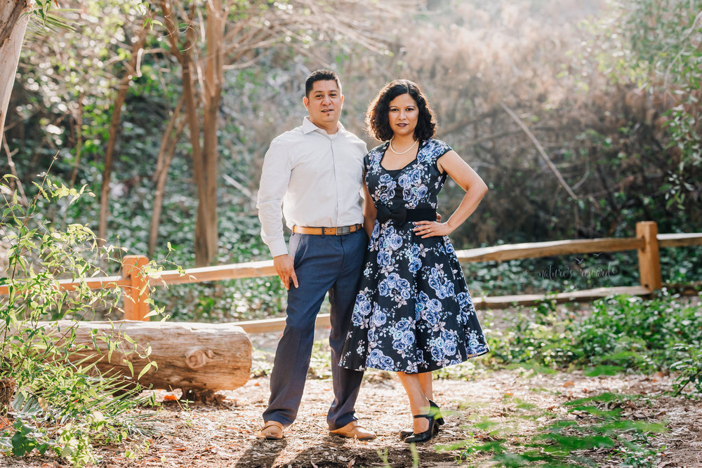 Beautiful couple wearing blues and blue floral dress in this gorgeous family photography portrait by Nature's Reward Photography.