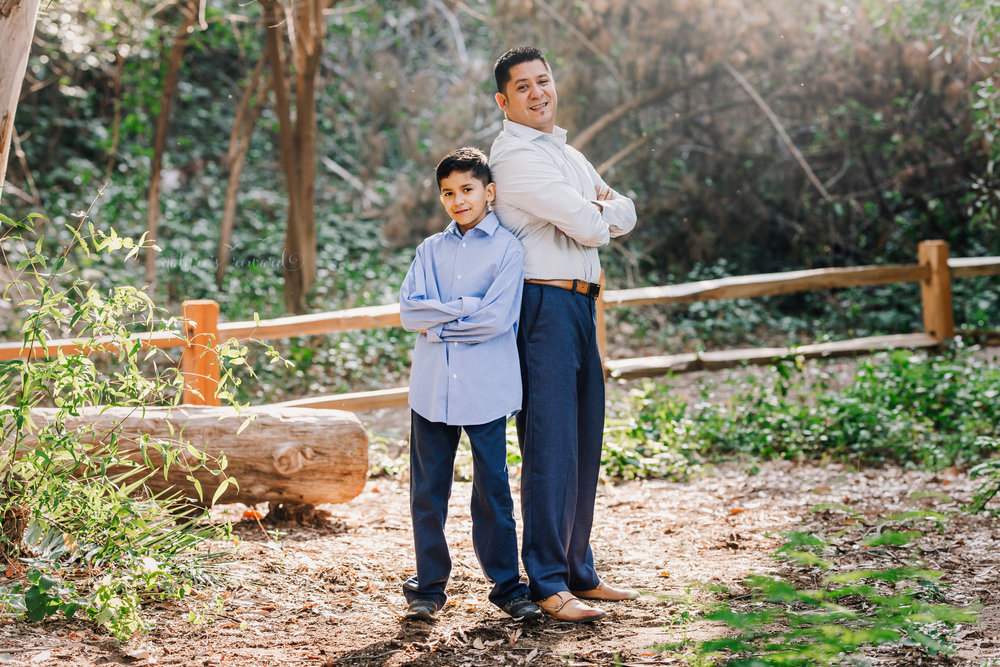 Just the boys wearing blues in this gorgeous dad and son photography portrait by Nature's Reward Photography.