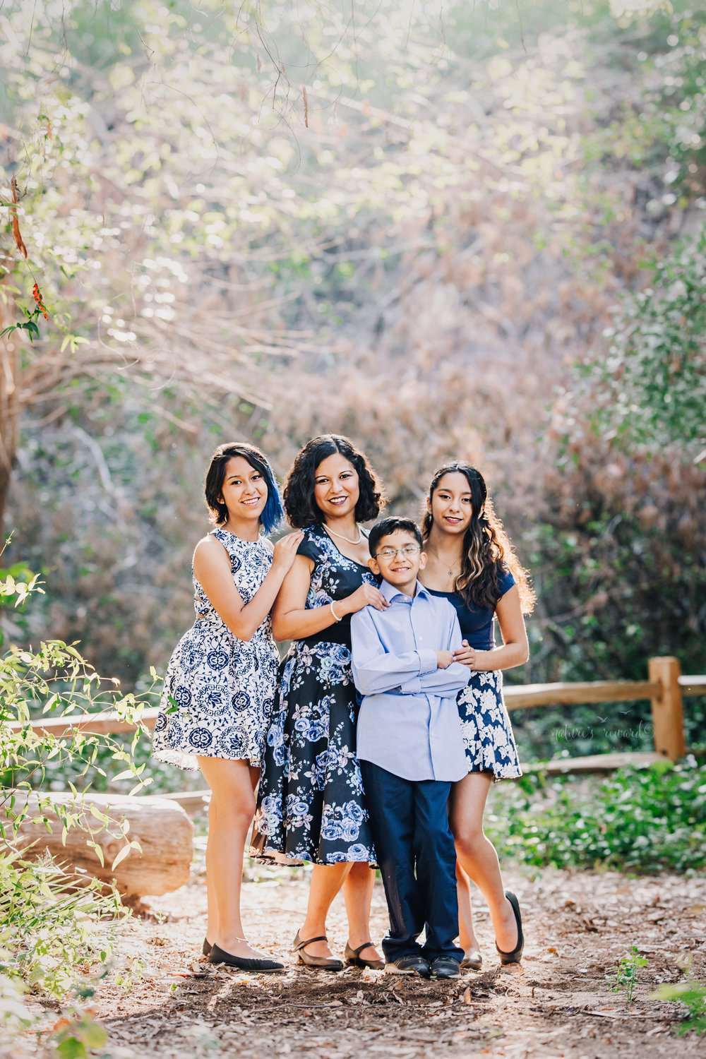 Just mom and us wearing blues and blue florals dresses in this gorgeous family photography portrait by Nature's Reward Photography.