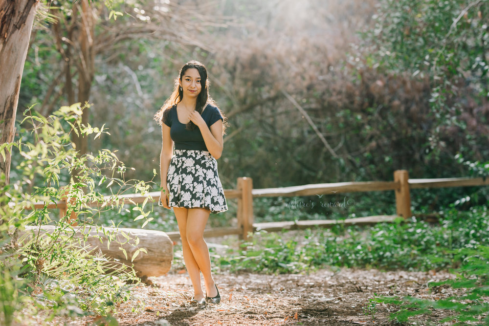 Beautiful young lady blue floral skirt in this gorgeous family photography portrait by Nature's Reward Photography.