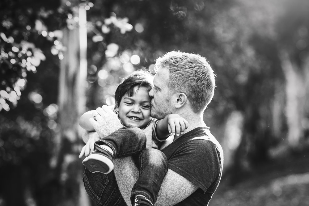 Father son portrait Family portrait on a tree lined dirt path by Nature's Reward Photography