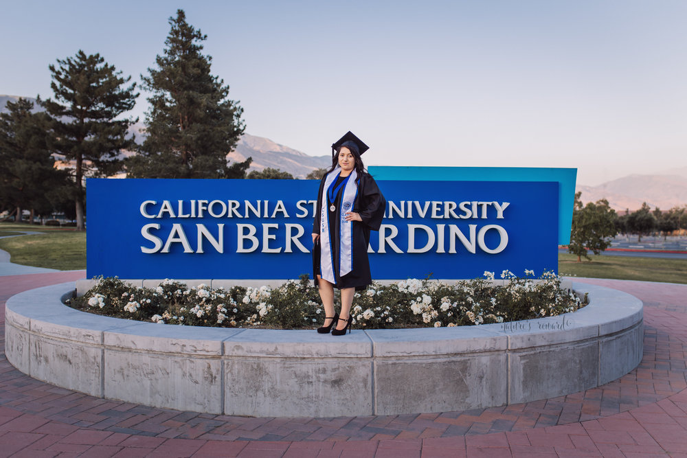Class of 2018, California State University, San Bernardino Graduate wearing a black dress and Cap and Gown, in this Senior Portrait by Nature's Reward Photography.