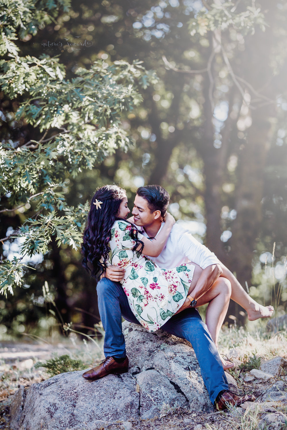 Gorgeous couple session in Lake Arrowhead Ca. featuring a floral summer dress and a long sleeves and pants in this beautiful portrait by San Bernardino photographer Nature's Reward Photography.