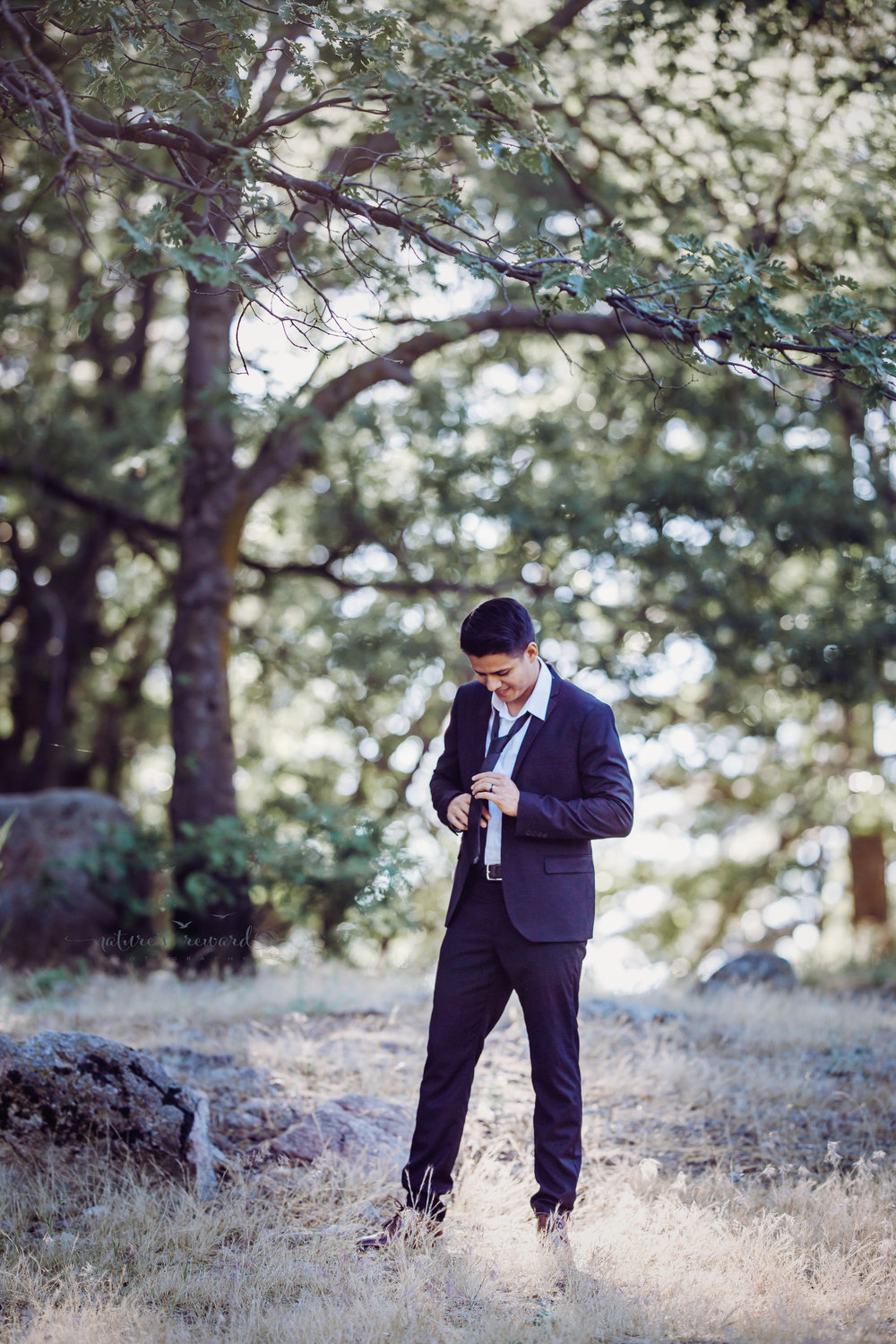 the groom getting ready- a portrait by Nature's Reward Photography