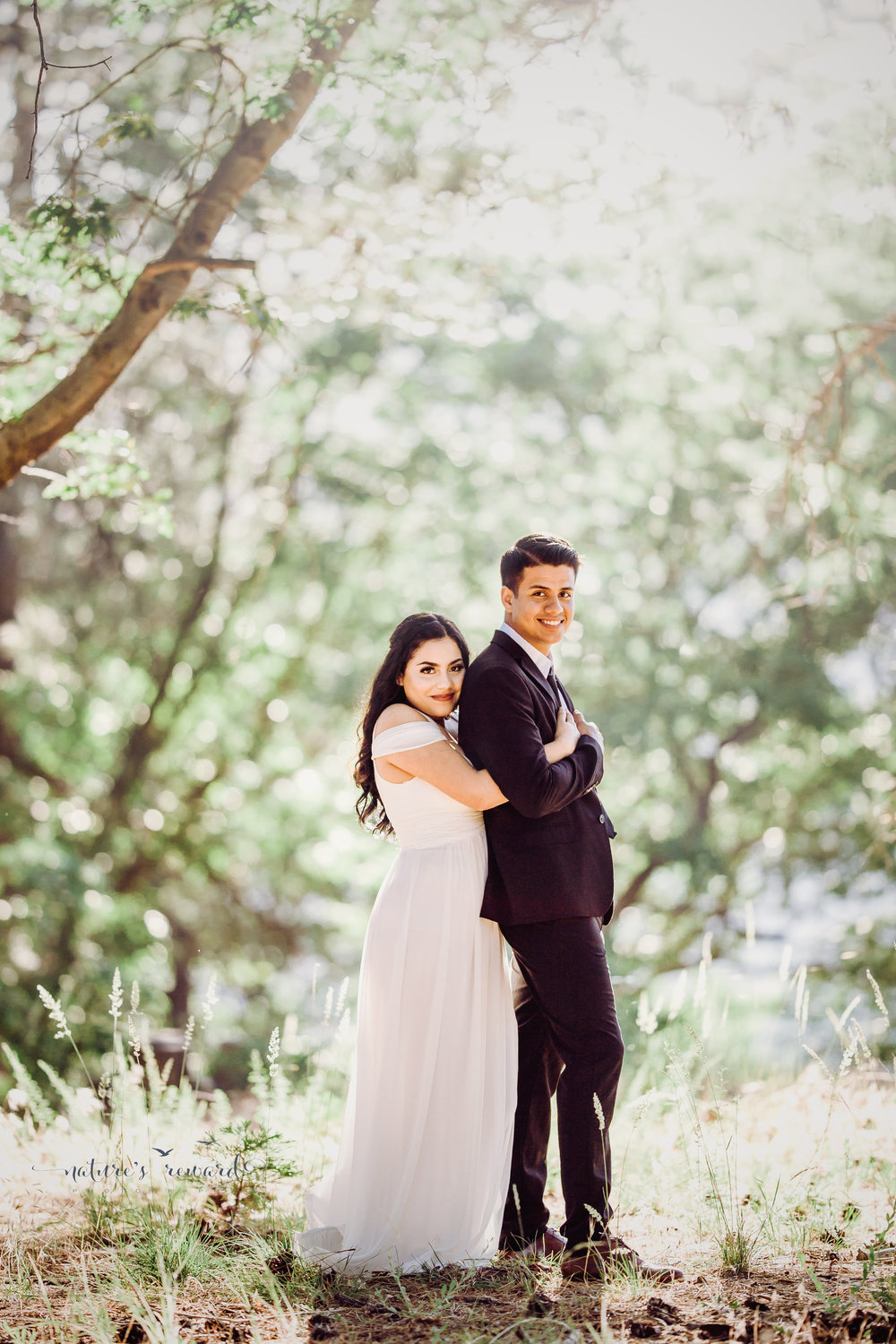 Very cute pose of bride and groom in this lovely portrait By Nature's Reward Photography