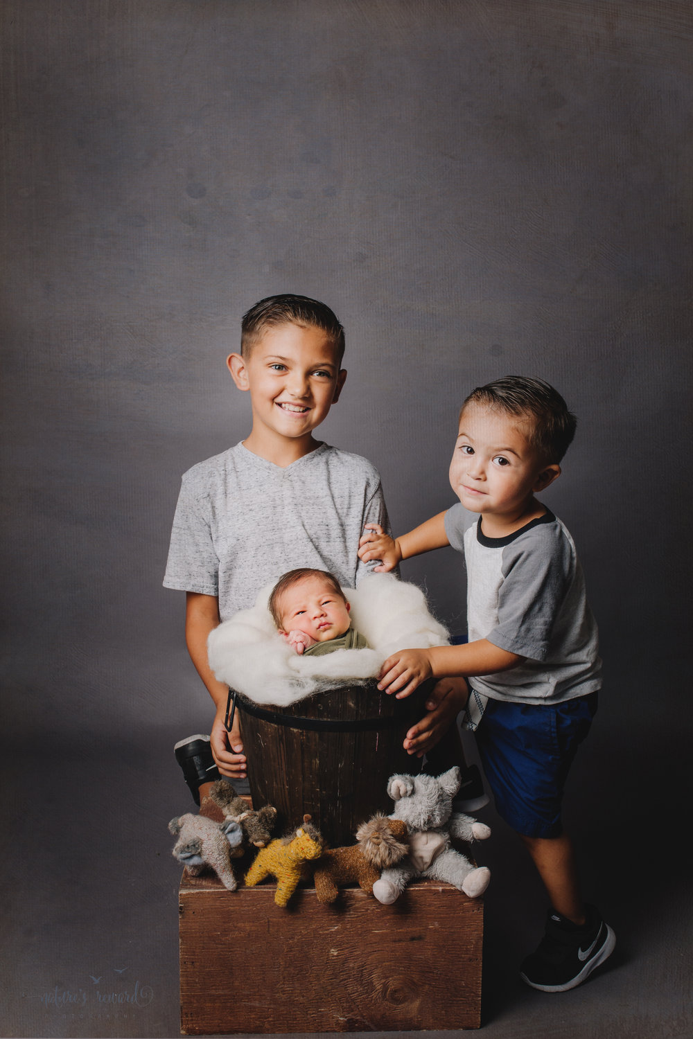Newborn Baby Boy and his big brother's in this sibling portrait by nature's Reward Photography