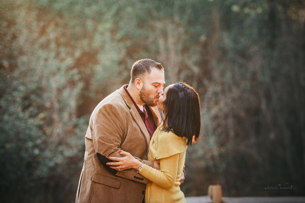 And Mom and dad kissed in the park.  A couple's portrait by Nature's Reward Photography