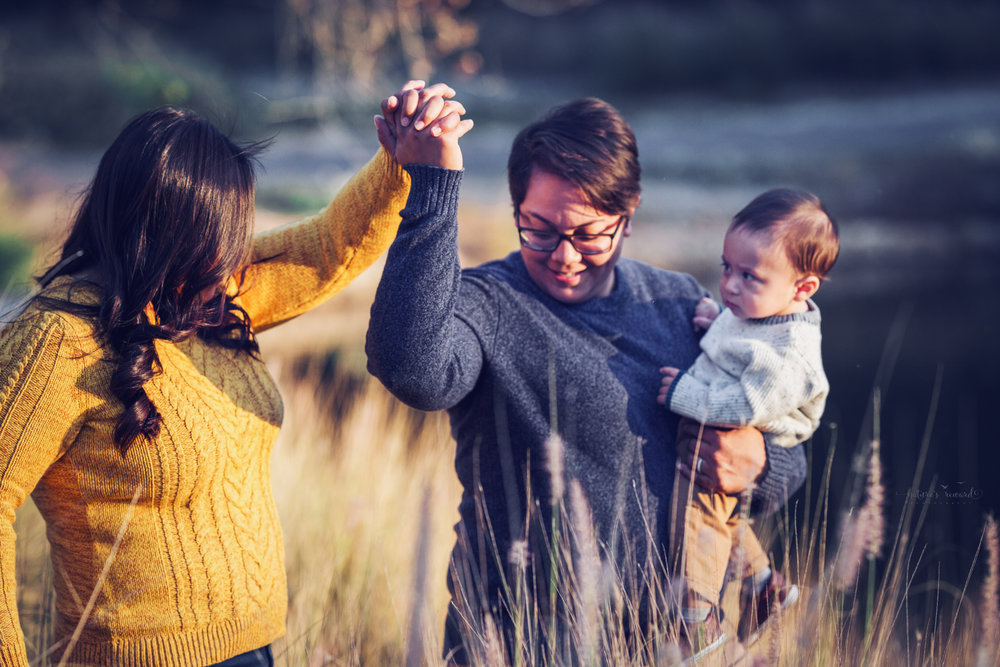 A candid family portrait by Nature's Reward Photography