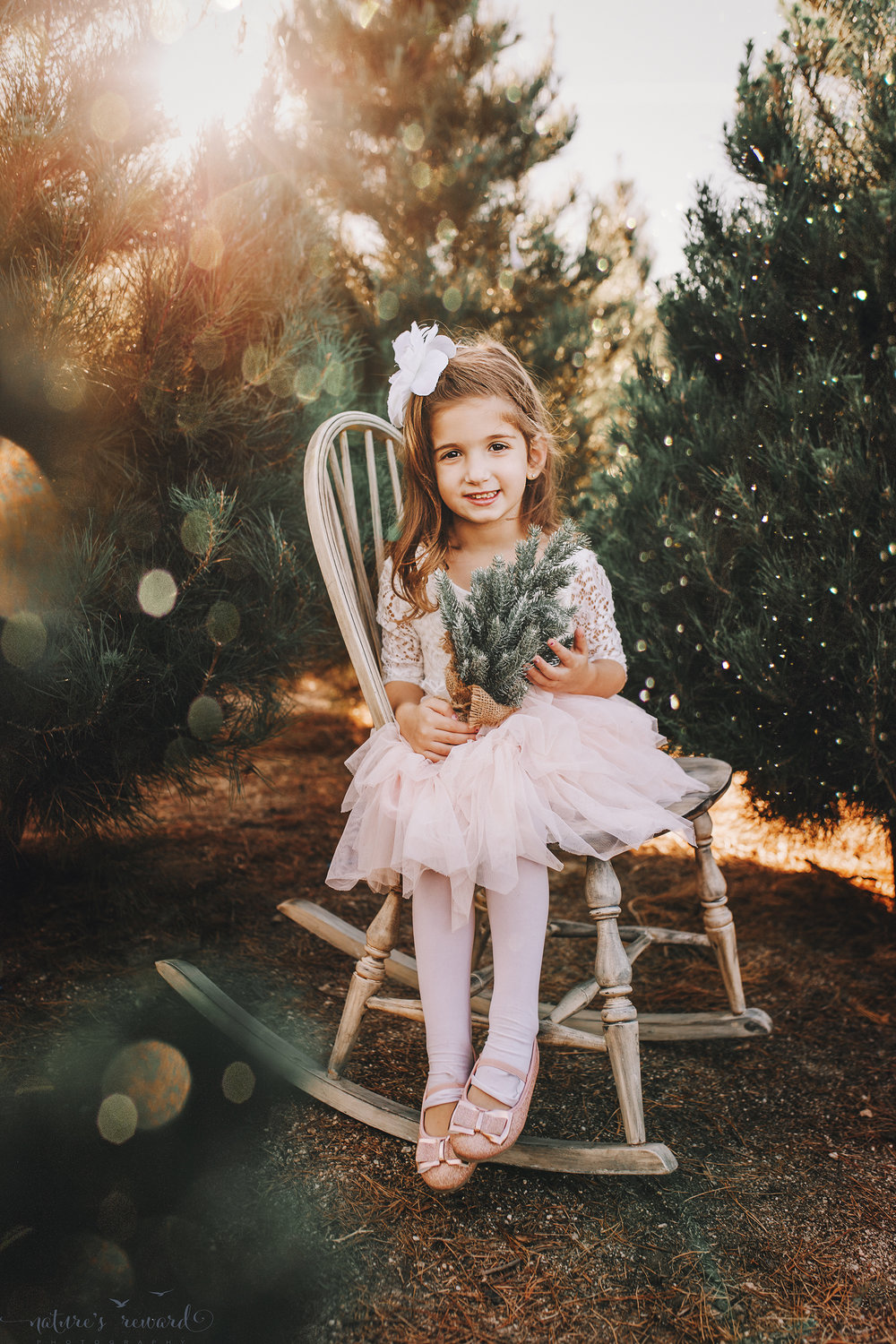 Sweet young girl -A Christmas tree farm portrait by Nature's Reward Photography