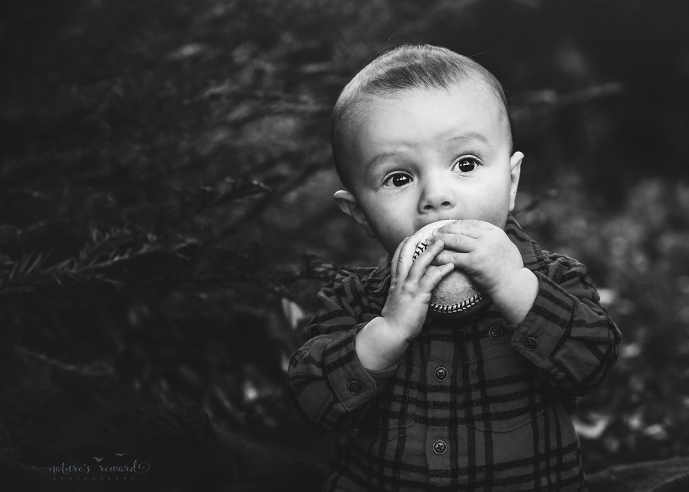 Black and white portraits6 month old baby boy and his baseball in a lush green park setting in Redlands, Ca. by San Bernardino photographer- Nature's Reward Photography
