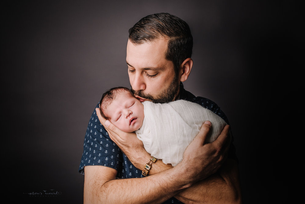 Newborn baby boy with his dad by san Bernardino's maternity, newborn and family photography, Nature's Reward Photography