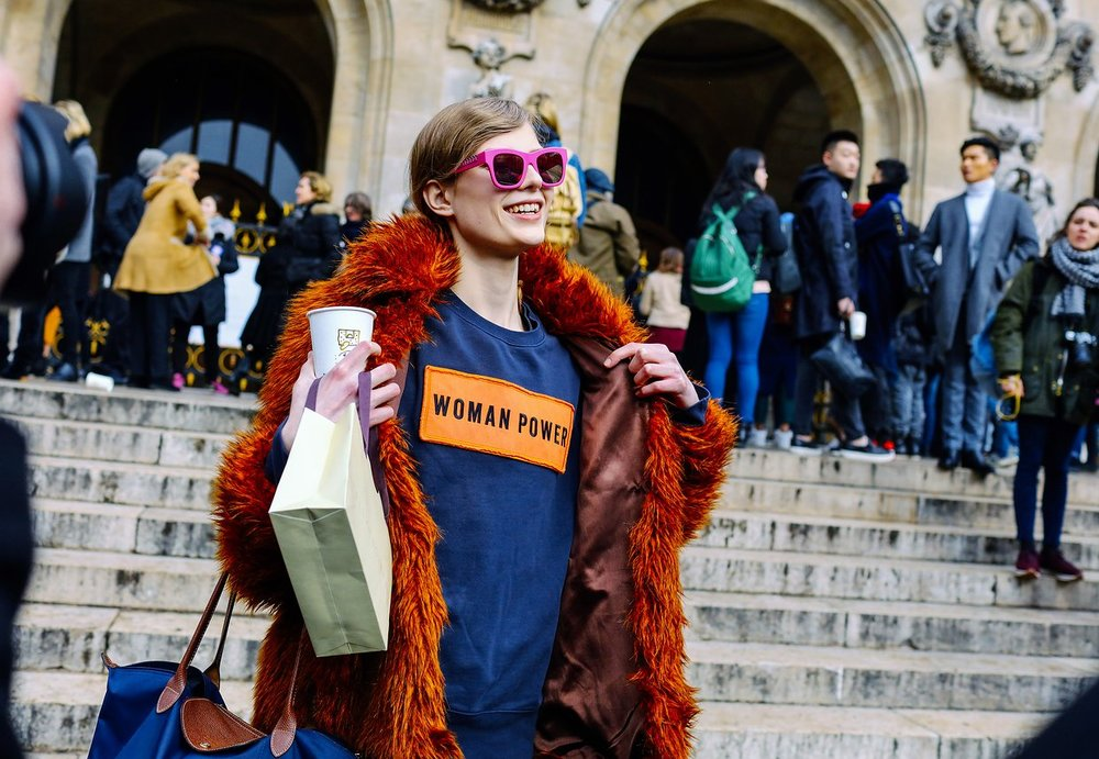 An Acne Studios sweatshirt, a Longchamp bag, and a Stella McCartney sunglasses,  image by Phil Oh , Paris Fashion Week 2016.