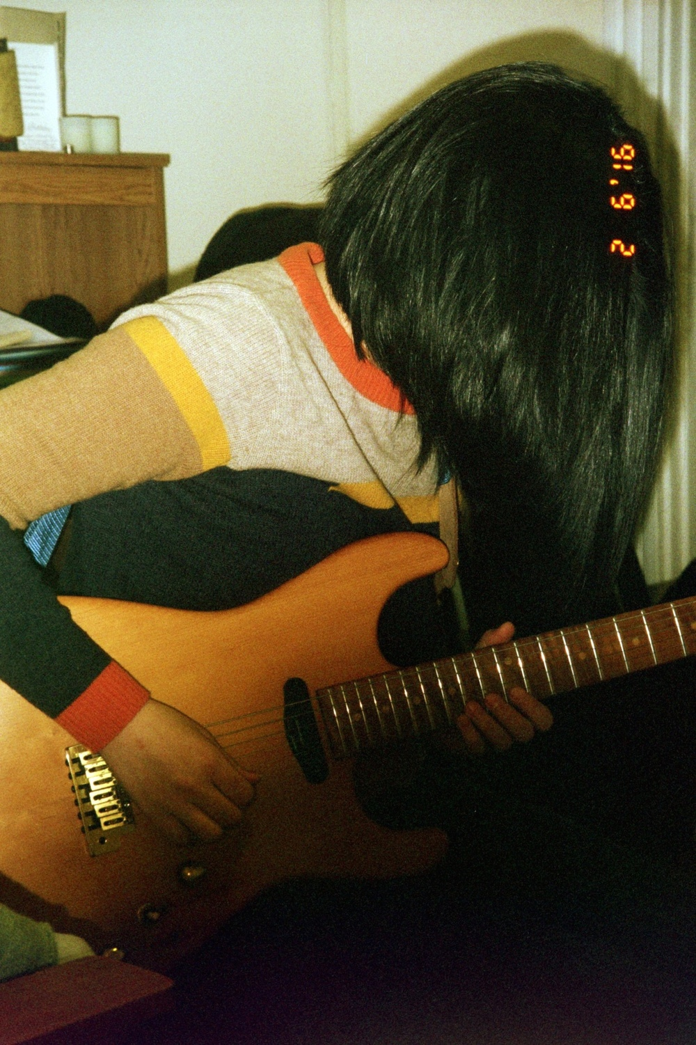 "Eunsea Min recording electric guitar on ""Party Dress""."