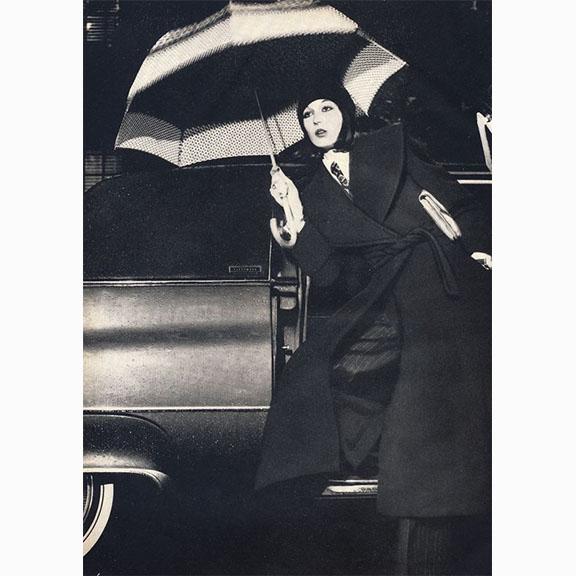 Chris Von Wangenheim, Angelica Houston in John Anthony Coat with Morris Moskowitz Clutch, and Uncle Same Umbrella, American Bazaar, September 1972