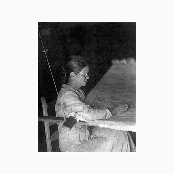 Unknown Photograph of a Woman Quilting