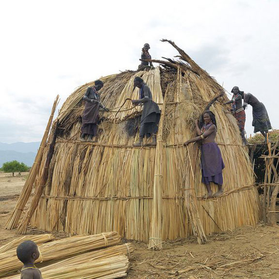 Erbore women building a new house Ethiopia
