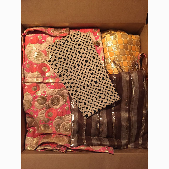 B Colvin, Moving Day, Photograph of Box Full of Beautiful Textiles, 2015