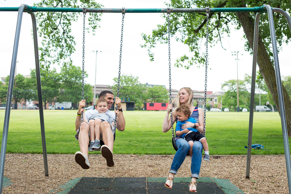 james-reid-family-on-swings.jpg