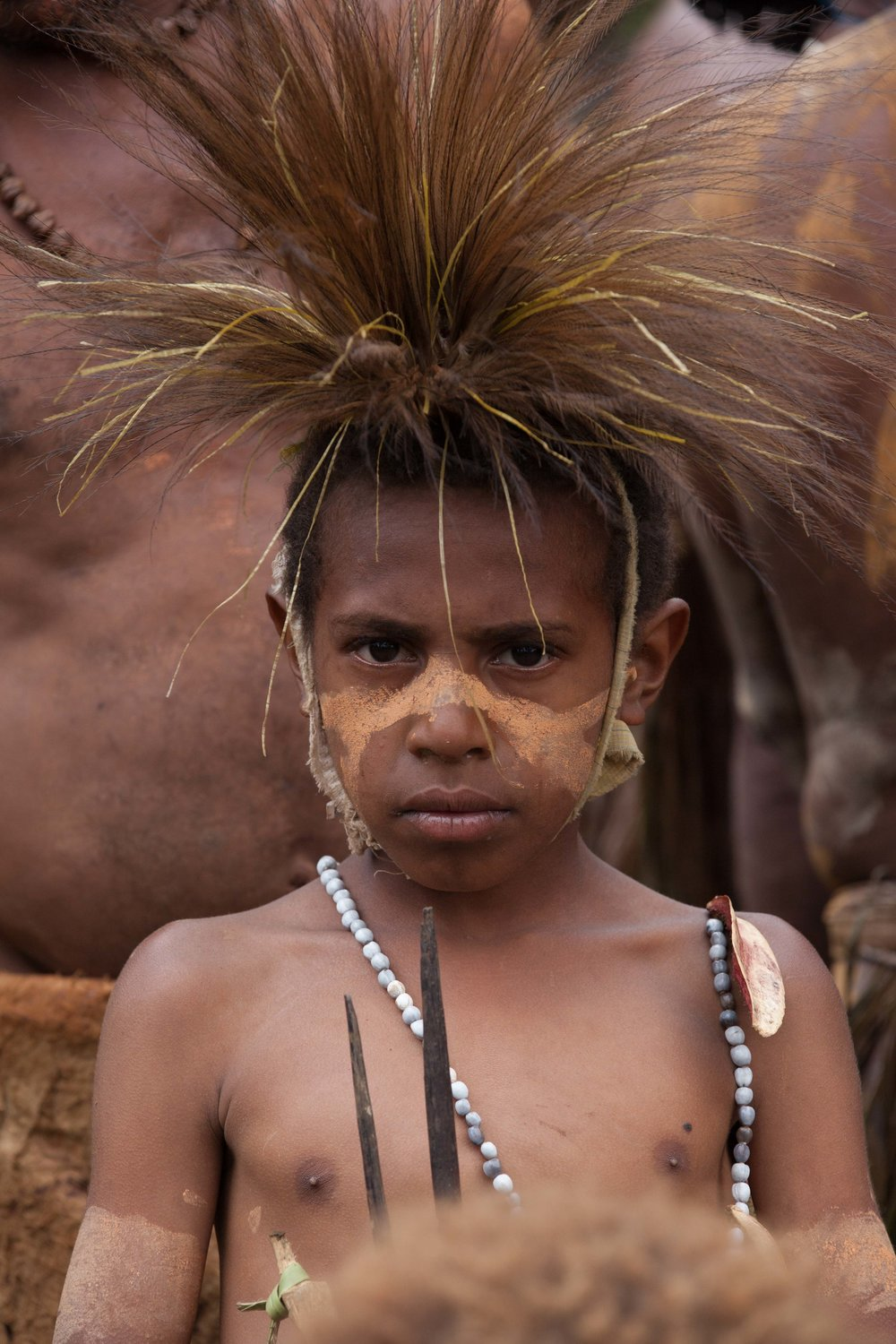 A child in traditional garb. Bollen village, Chimbu province