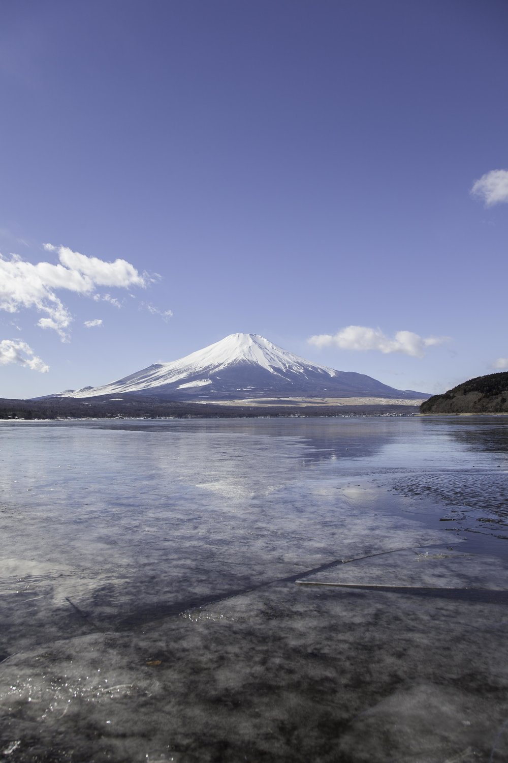 Mt Fuji reflected in frozen  Lake Yamanaka