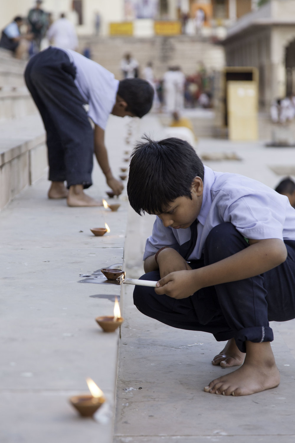 Children lighting lamps for  Kartika Purnima
