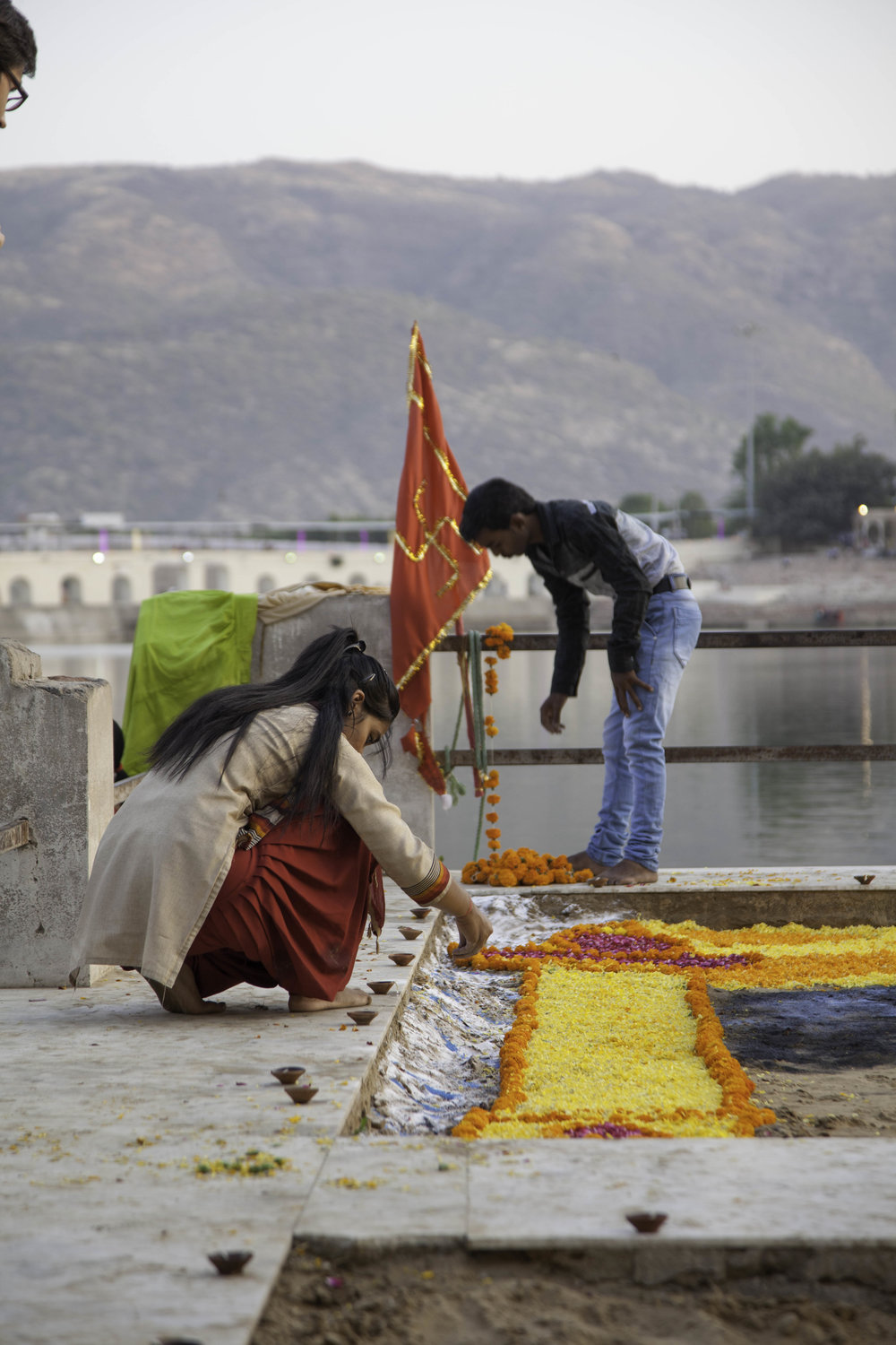 Decorating the ghats with flowers and pigments