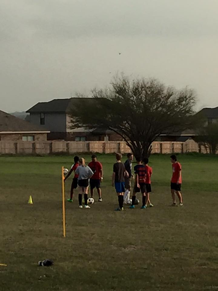 local kids' soccer team practicing on our huge lot.