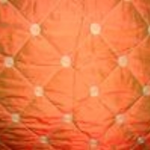 Dupione Quilted Rust  Style: Silk ID: 11345 Retail Price: $32.90 Content: 100% Silk