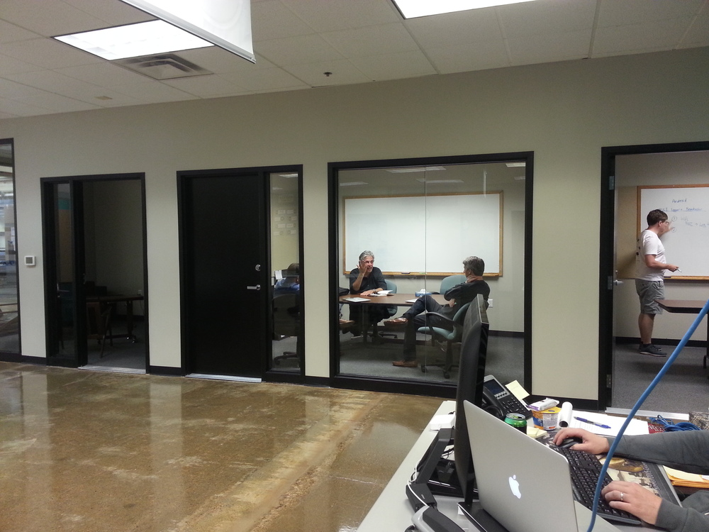 "2 conference rooms are on the far side of the Garage, with the ""phone booth"" rooms located on the opposite wall"
