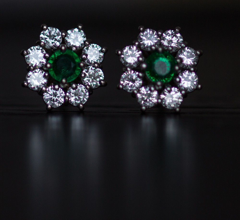 Platinum Crafted Emerald & Diamond Halo Earrings, circa 1990s Tiffany & Co. signature collection.
