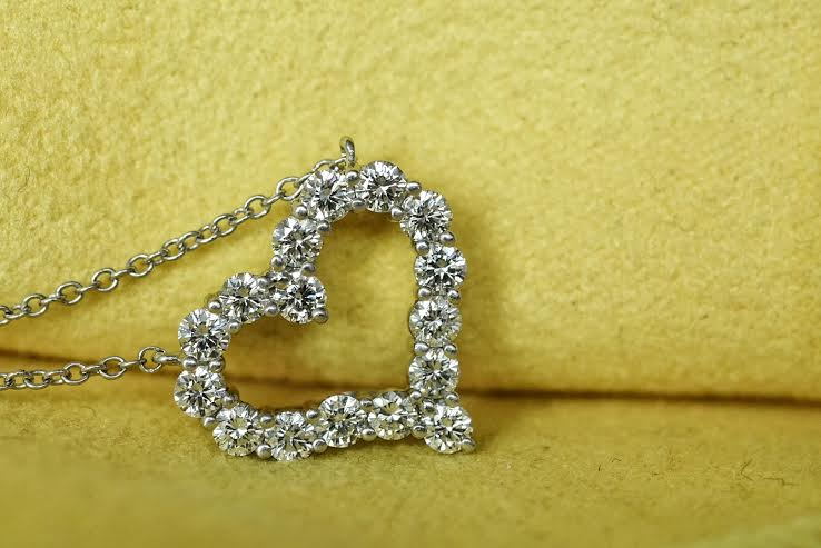 Platinum Crafted 1cttw Diamonds Heart Shape Pendant & Lobster-Clasp Necklace, retails for approximately $7000. A signature Tiffany & Co jewelry piece!