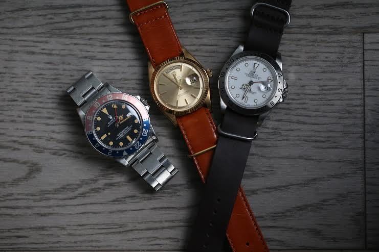 From Left to Right: Vintage Rolex GMT Circa 1960 | Rolex Daydate Yellow Gold on a custom distressed leather strap | Rolex Explorer on a custom black leather strap