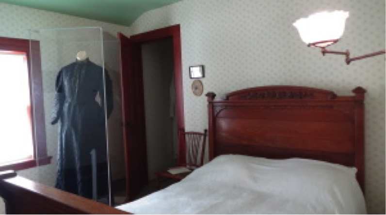 The black dress made from Utah silk, in Anthony's bedroom. Photo courtesy National Susan B. Anthony Museum & House