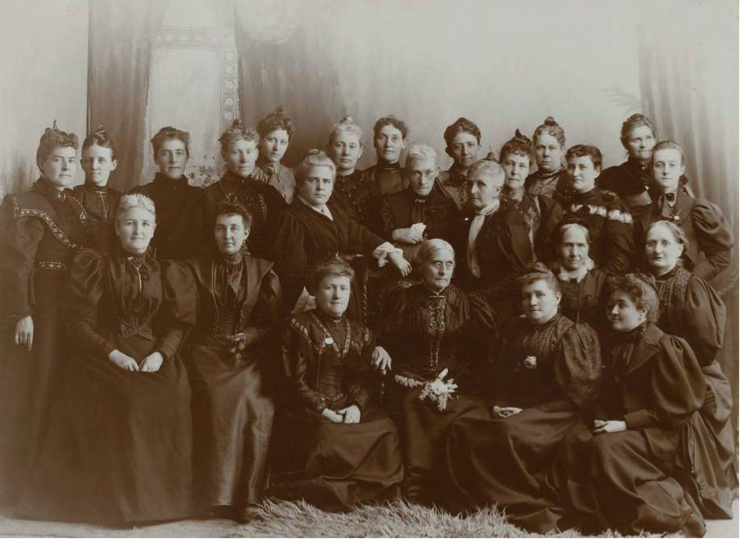 Susan B. Anthony (seated at center) met with Western suffragists, including Utahns Martha Hughes Cannon (standing, far left), Electa Bullock (seated, far left), Sarah M. Kimball (standing directly behind Anthony), Emmeline B. Wells (standing to Anthony's left) and Zina D. H. Young, (seated directly left of Wells), at the 1895 Rocky Mountain woman suffrage convention in Salt Lake City.