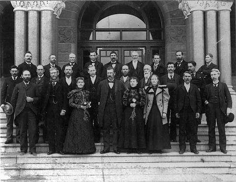 Martha Hughes Cannon (left of center), the first female state senator in the United States, with the rest of Utah's senate on the steps of the Salt Lake City and County Building, 1897. The other two women in the photo were clerks for the senate.