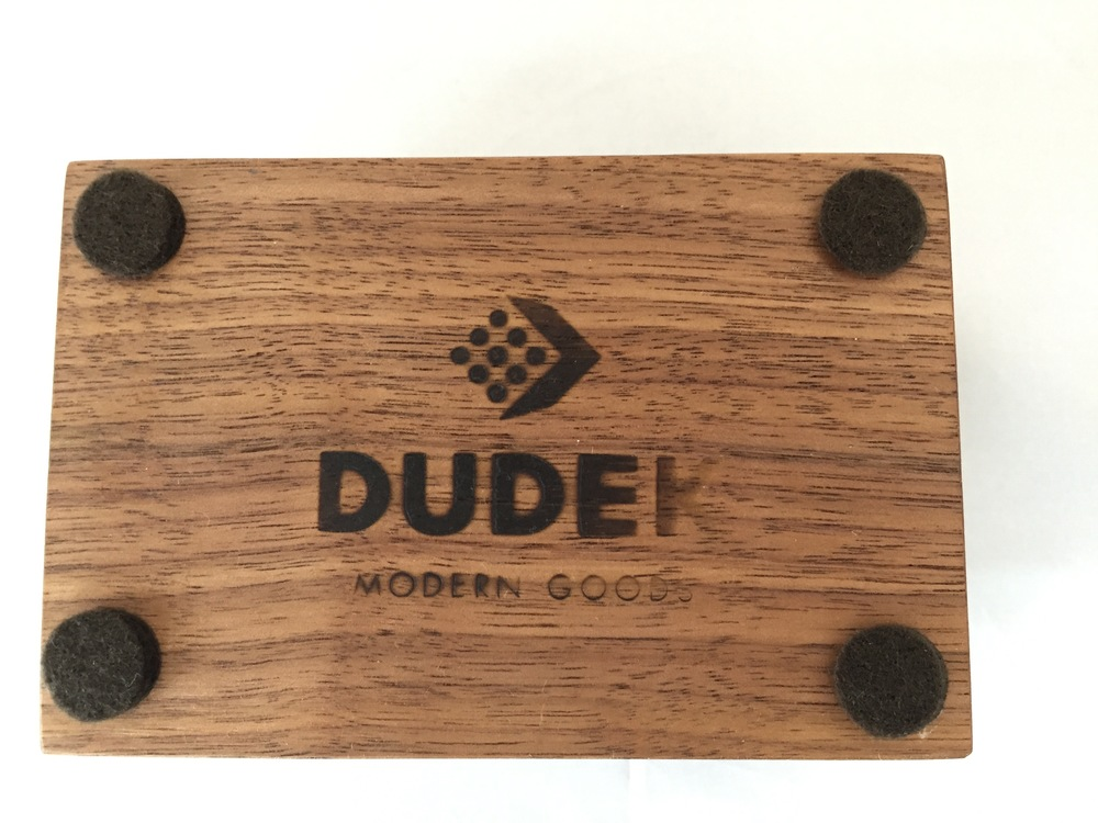 Four felt feet surround the Dudek Modern Goods logo on the bottom of the Idea Dock