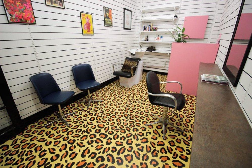 The trendy Peckham hair salon has leopard print floors!