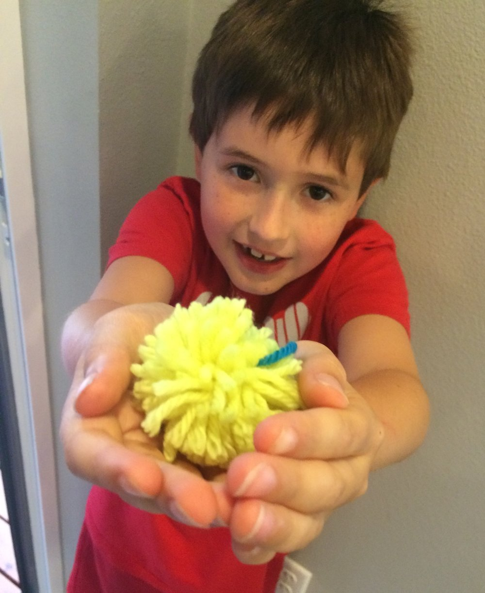 Boys love making pompoms, too.