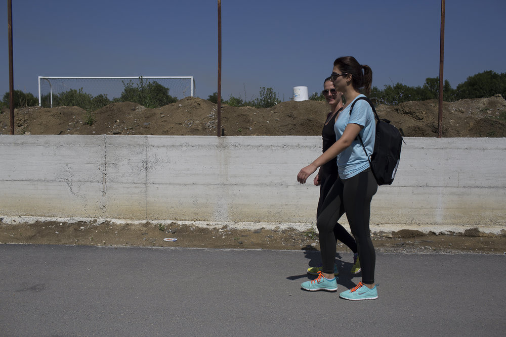 Kaltrina and Agnesa walk home after working out in the park. Kaltrina is in her first year of a masters degree for physical education.