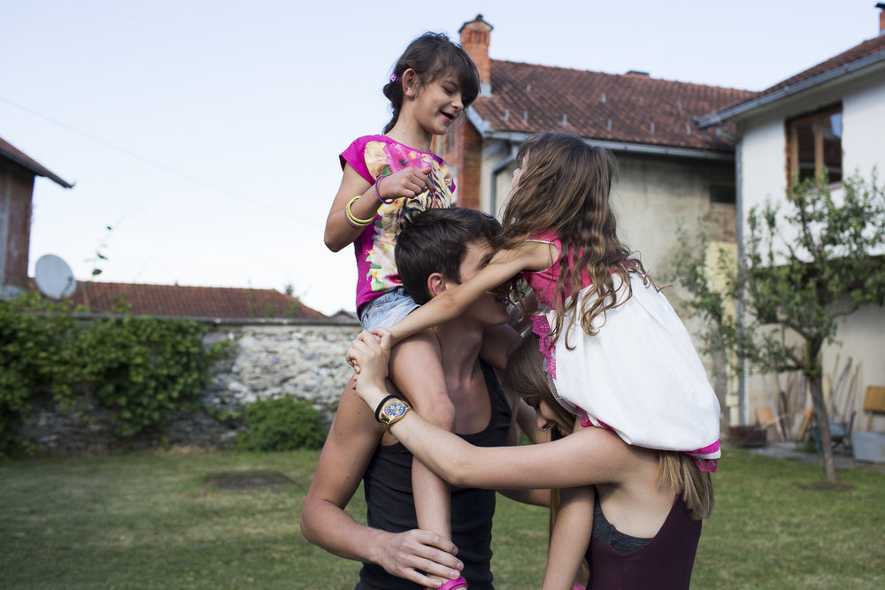 Fatlinda Rrustemaj (bottom right) play fights with her cousins during Bajram celebrations on July 5, 2016 in Peja, Kosovo. Bajram marks the end of the Ramadan and is celebrated through traditional food and spending time with family.