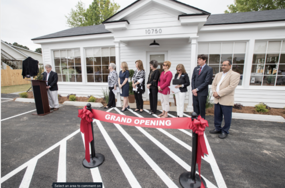 Local historian Buddy Sullivan speaks at the grand opening. Also, pictured, Richmond Hill Convention & Visitors Bureau Chairman Bonnie Proctor, Executive Director Christy Sherman, board members Sherri Broome, Pam Shores, Shannon GaNun, Richmond Hill Historical Society President Paige Glazer, Mayor Russ Carpenter and Richmond Hill CVB Vice Chairman Kenny Patel.