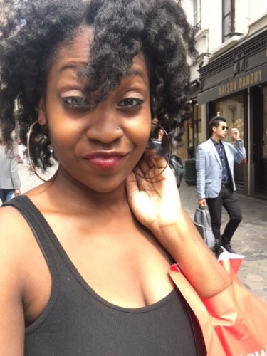 Smirking because my flat twistout was IMMACULATE and I just scored chocolate in Brussels.