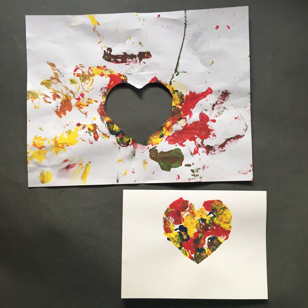 I cut out a heart from a regular piece of paper-creating a stencil. I taped my card to the back of the heart stencil. My daughter covered everything in paint but when I removed the paper heart stencil cut out, we were left with this beautiful painted heart on the card.