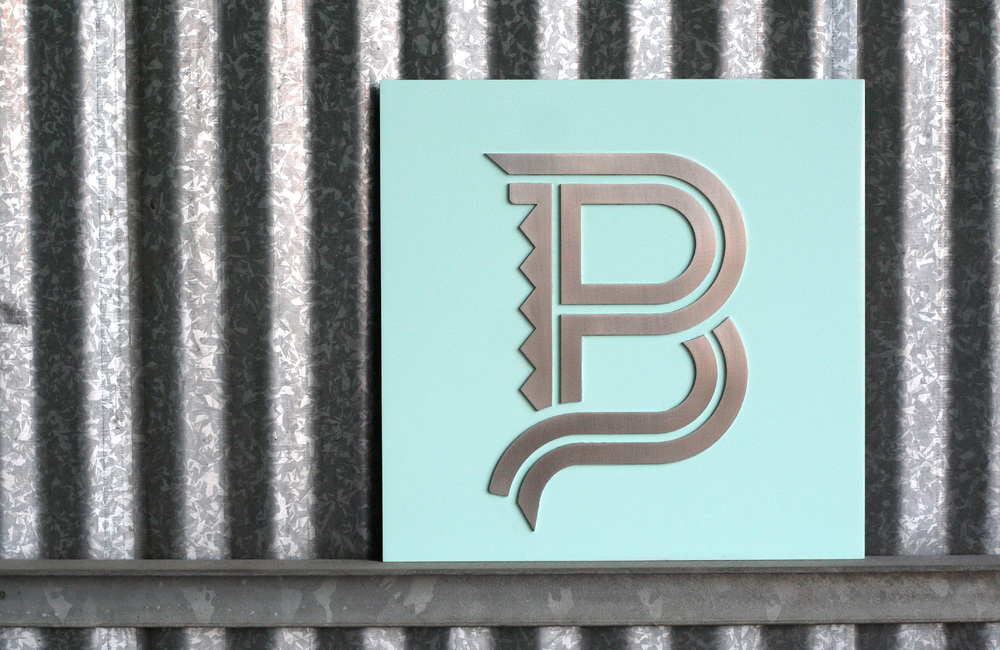 BLUE POBLANO SIGN: Custom cut, brushed metal sign, hand-painted using Blue Poblano's specific brand color.