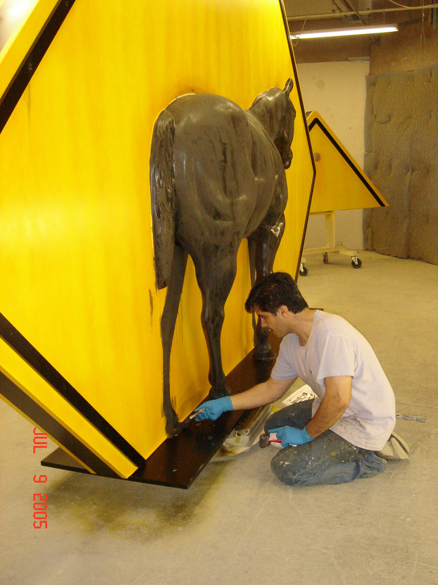 Painting process, applying the faux rust patina.  Rochester, NY 2005.